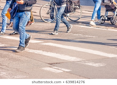 people-crossing-pedestrian-on-sunny-260nw-639814276